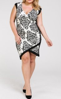 Full body view of a plus size model in a Black and White Contrast BodyCon dress