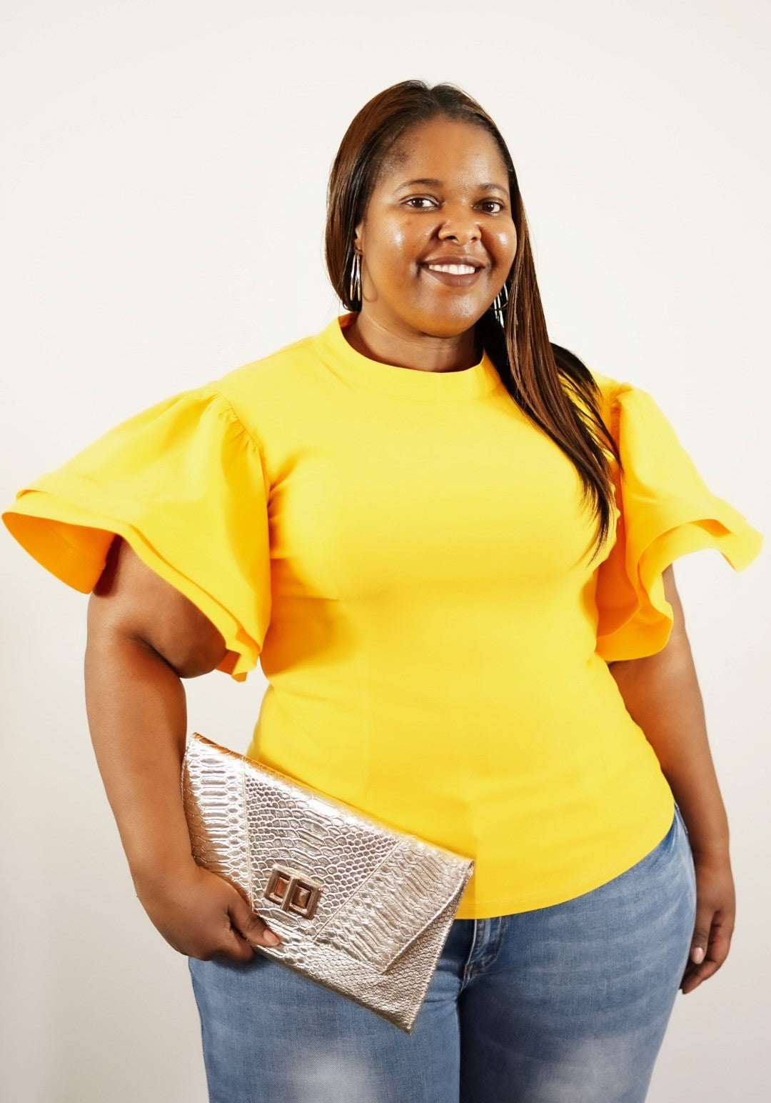 Front waist up view of a plus size model in a Yellow Mary Jane's Solid Short Siv Top