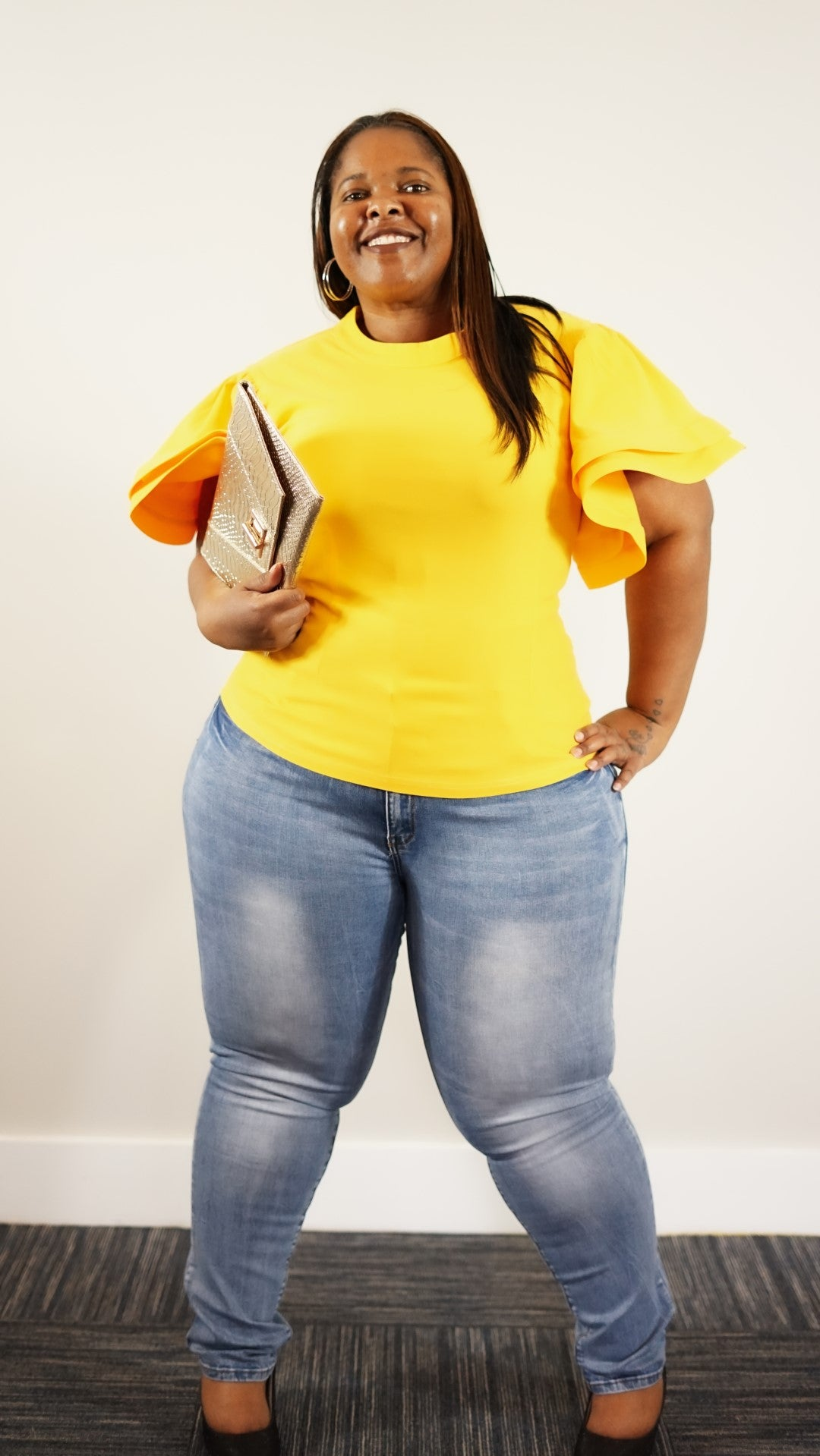 Front full body view of a plus size model in a Yellow Mary Jane's Solid Short Siv Top