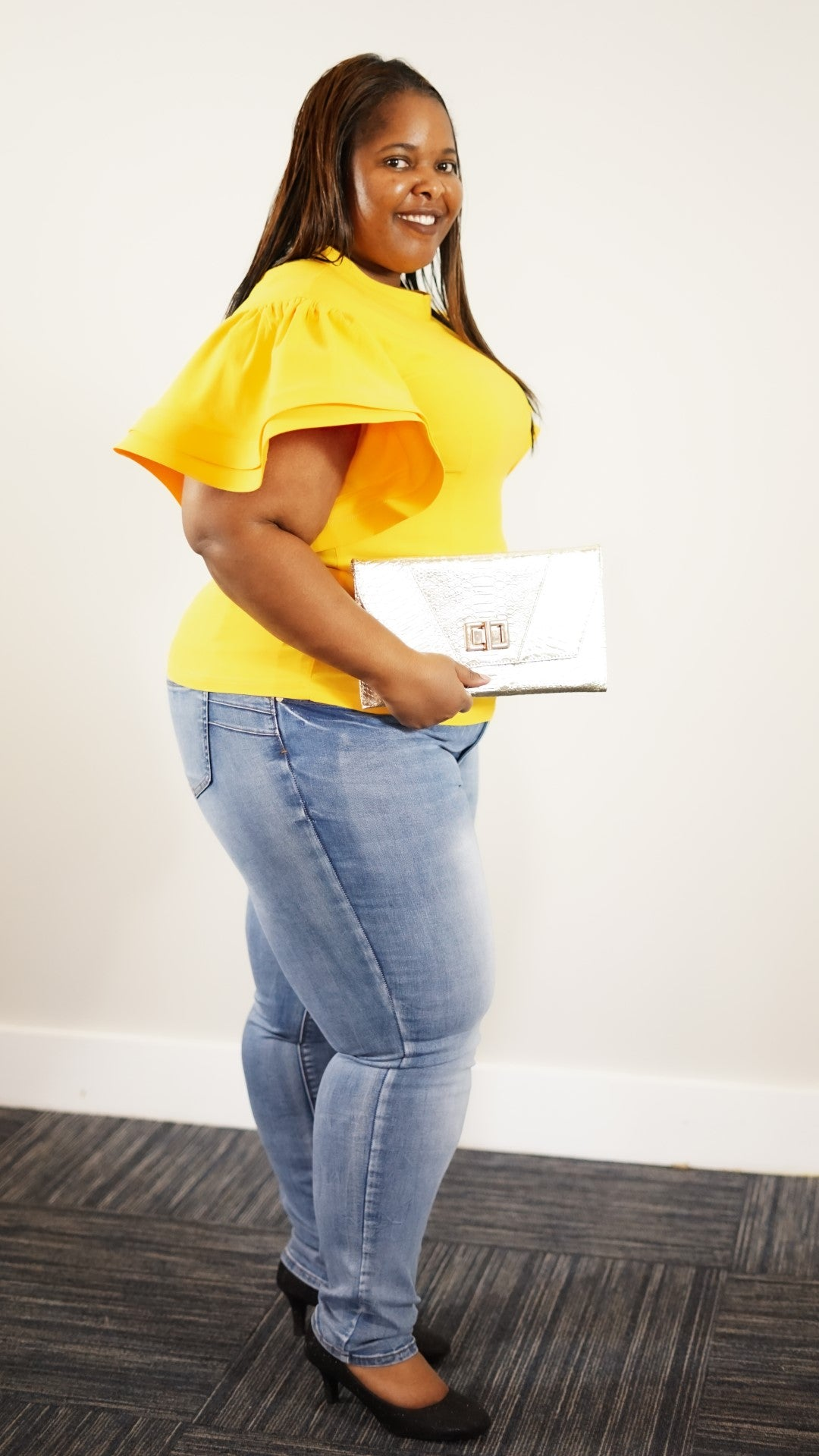 Side full body view of a plus size model in a Yellow Mary Jane's Solid Short Siv Top