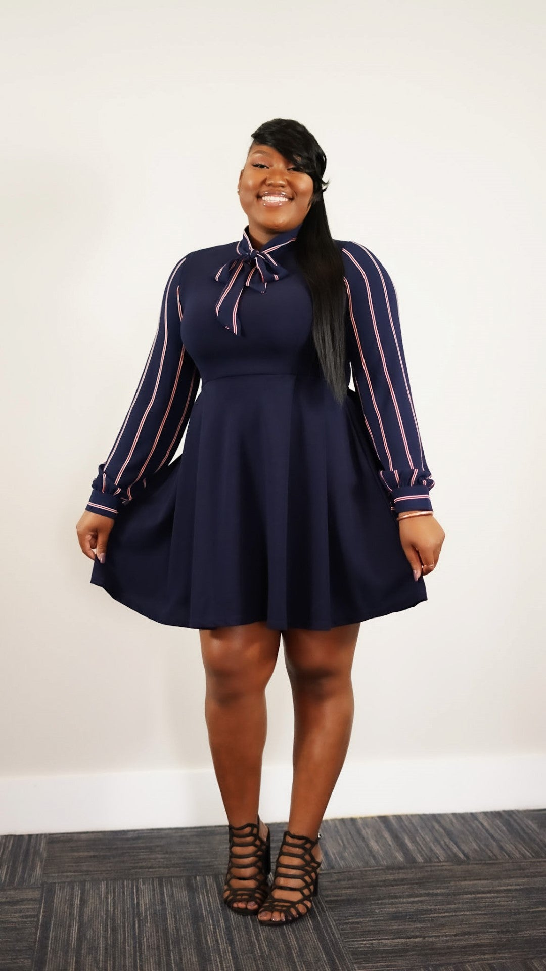 Front full body view of plus size model in a She-RO Navy & Red Stripe Crepe Sleeve Fit & Flare Dress