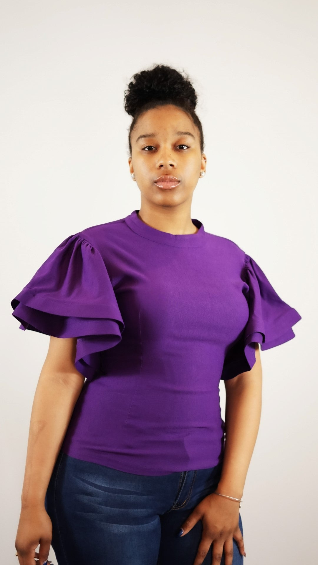 Front waist up view of a plus size model in a Purple Mary Jane's Solid Short Siv Top