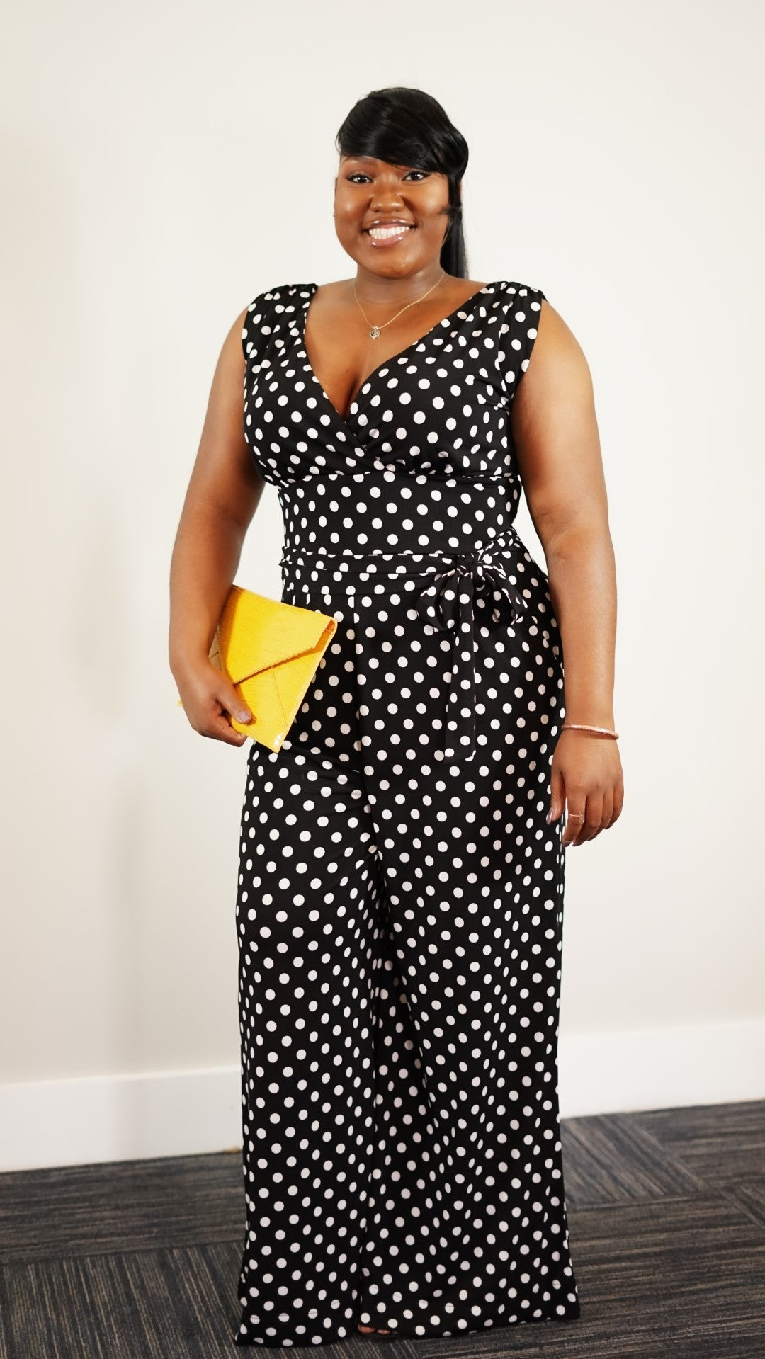 Front full body view of a plus size model in a Montgomery Jumpsuit With Pockets