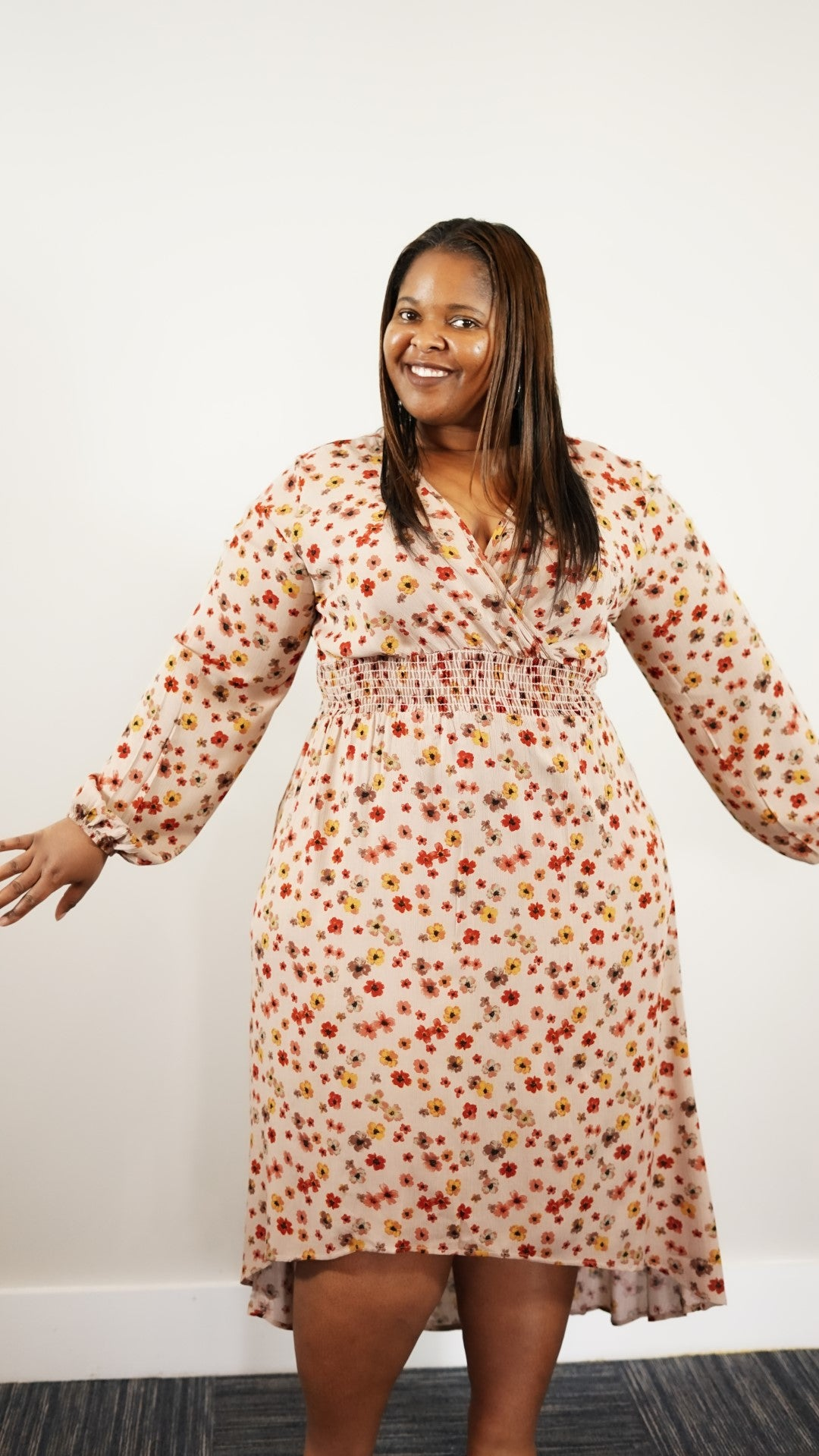 Front full body view of plus size model in a Floral Smocked Waist Dress