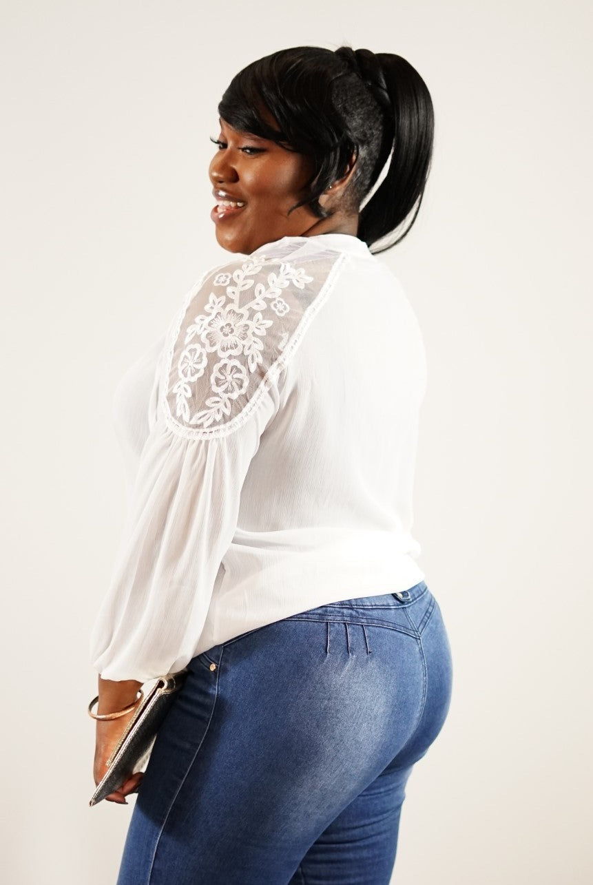 Side upper body view of plus size model in Trendy Widow Lace Blouse With Working Front Tie In White