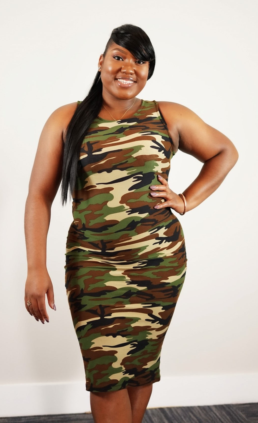 Front knee up view of plus size model in a Curvy and Sassy Camo Maxi Dress