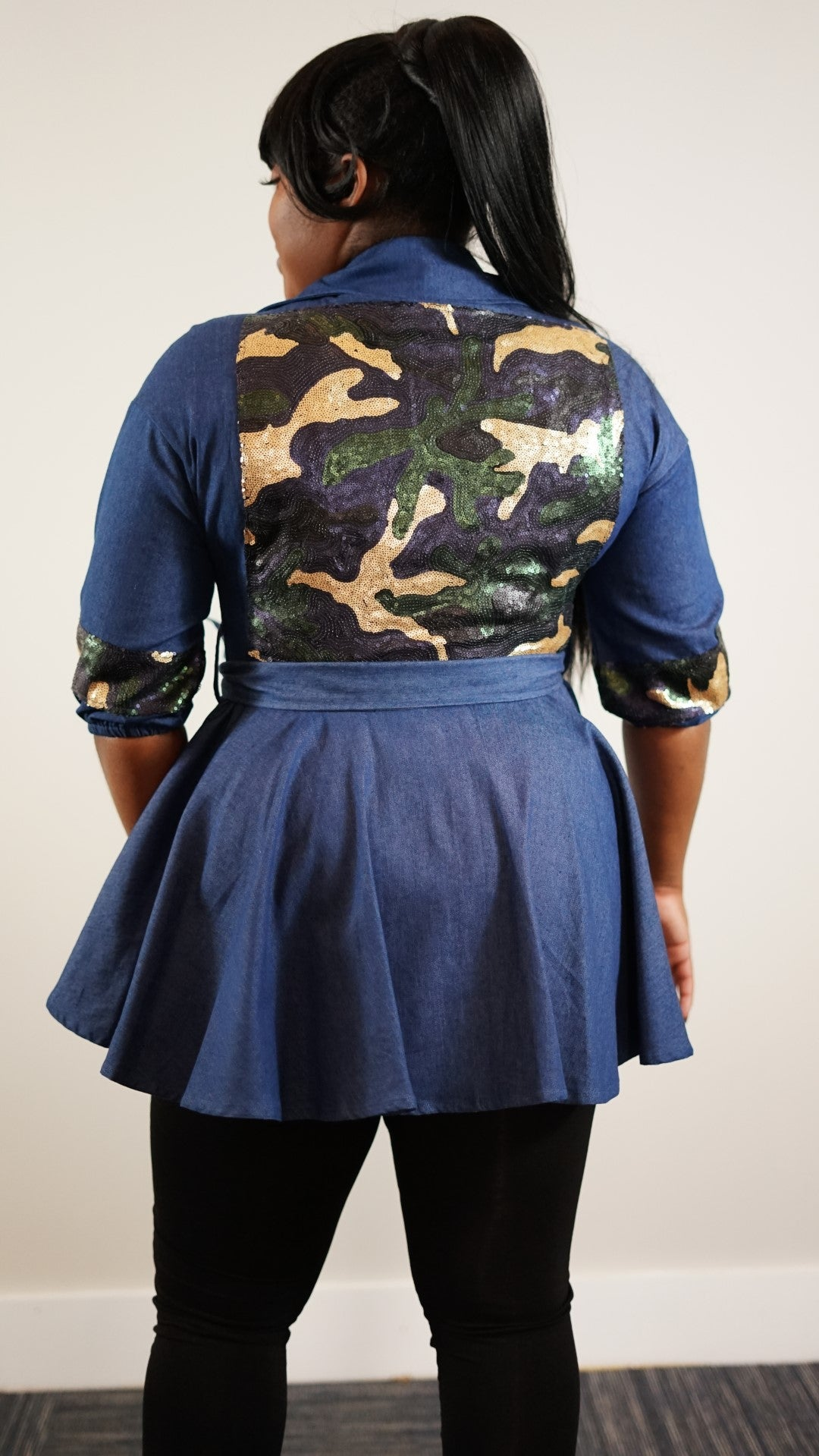 Back knee up view of plus size model in a Dazzling Back Camo Jacket With Tie Belt