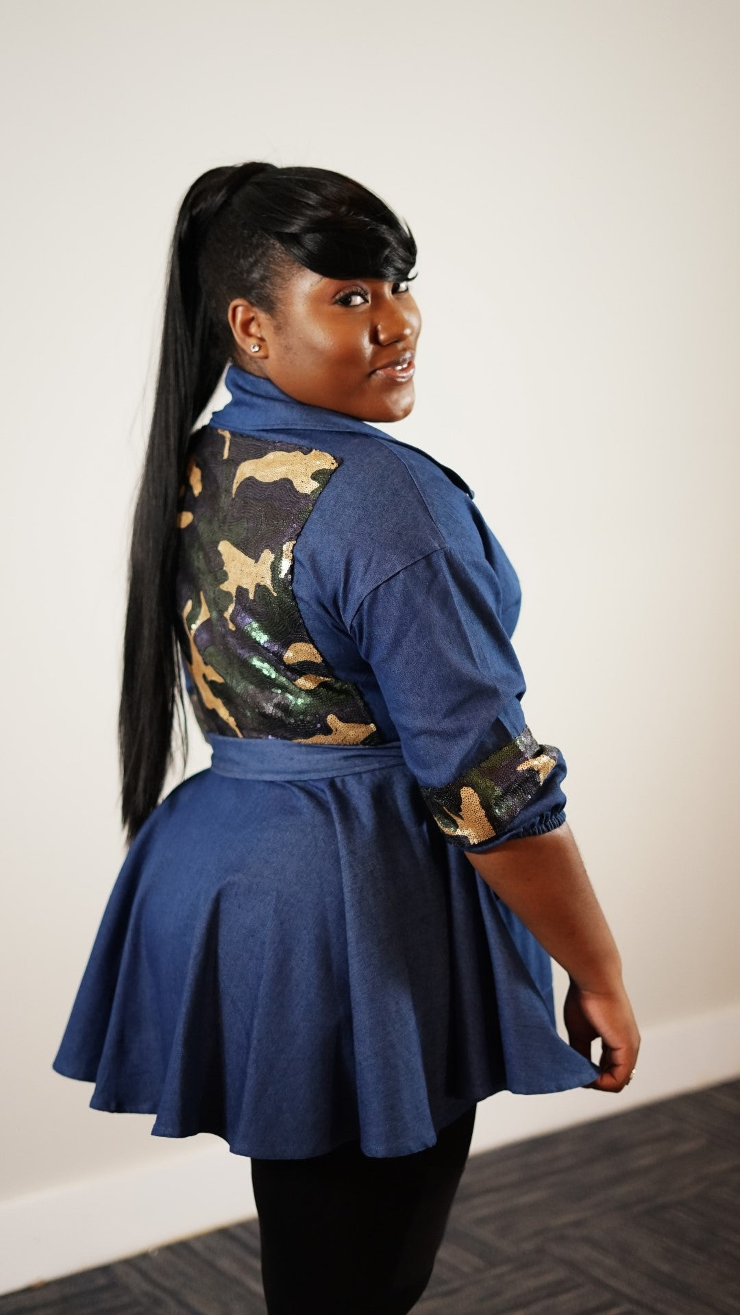 Side knee up view of plus size model in a Dazzling Back Camo Jacket With Tie Belt