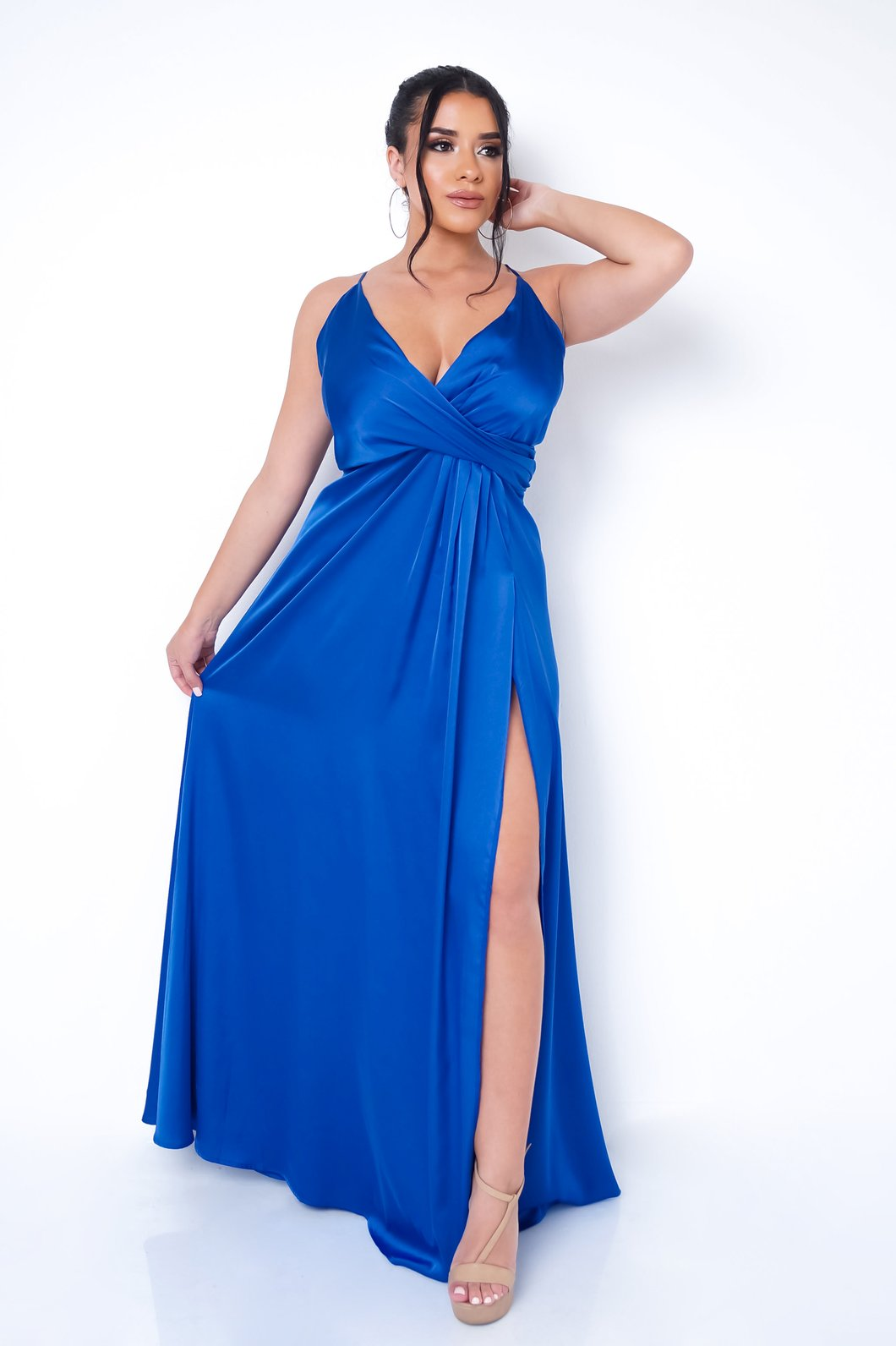 Front full body view of a plus size model in a blue beauty gown with a high slit