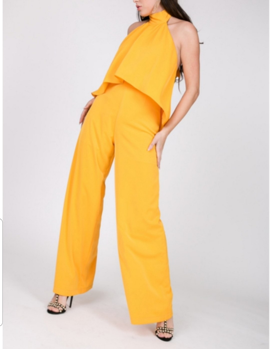 Front full body view of plus size model in Golden Back Out Jumpsuit