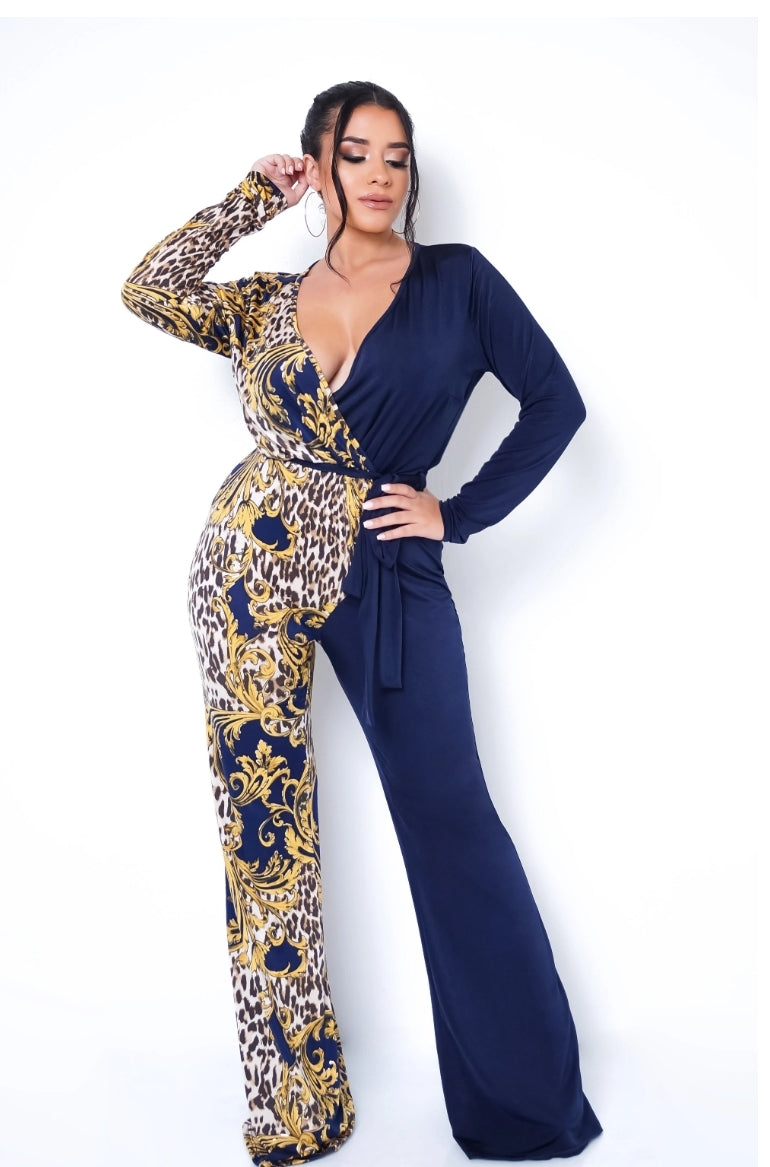 Front full body view of a plus size model in a Print/Black Jumpsuit In Navy