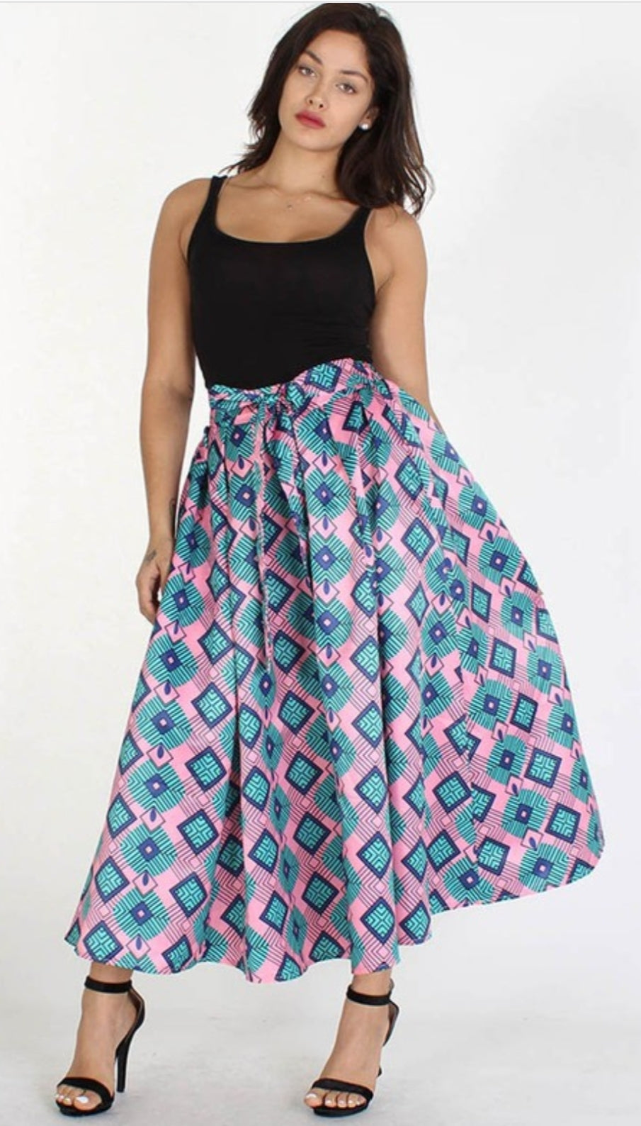 Front full body view of plus size model in a Diamond Pink Print Skirt