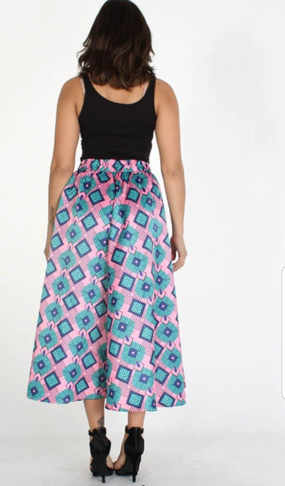 Back full body view of plus size model in a Diamond Pink Print Skirt