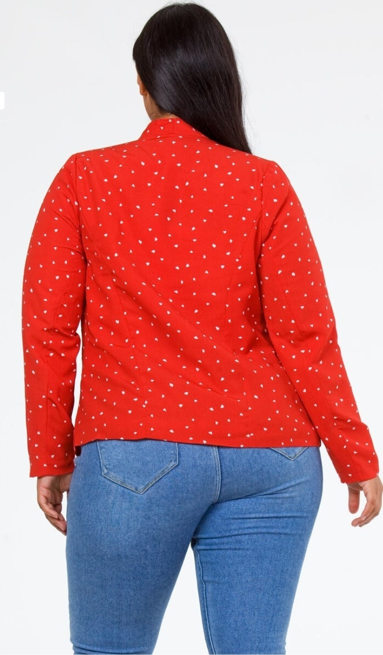Back knee up view of a plus size model in a Red Heart of Hearts Blazer