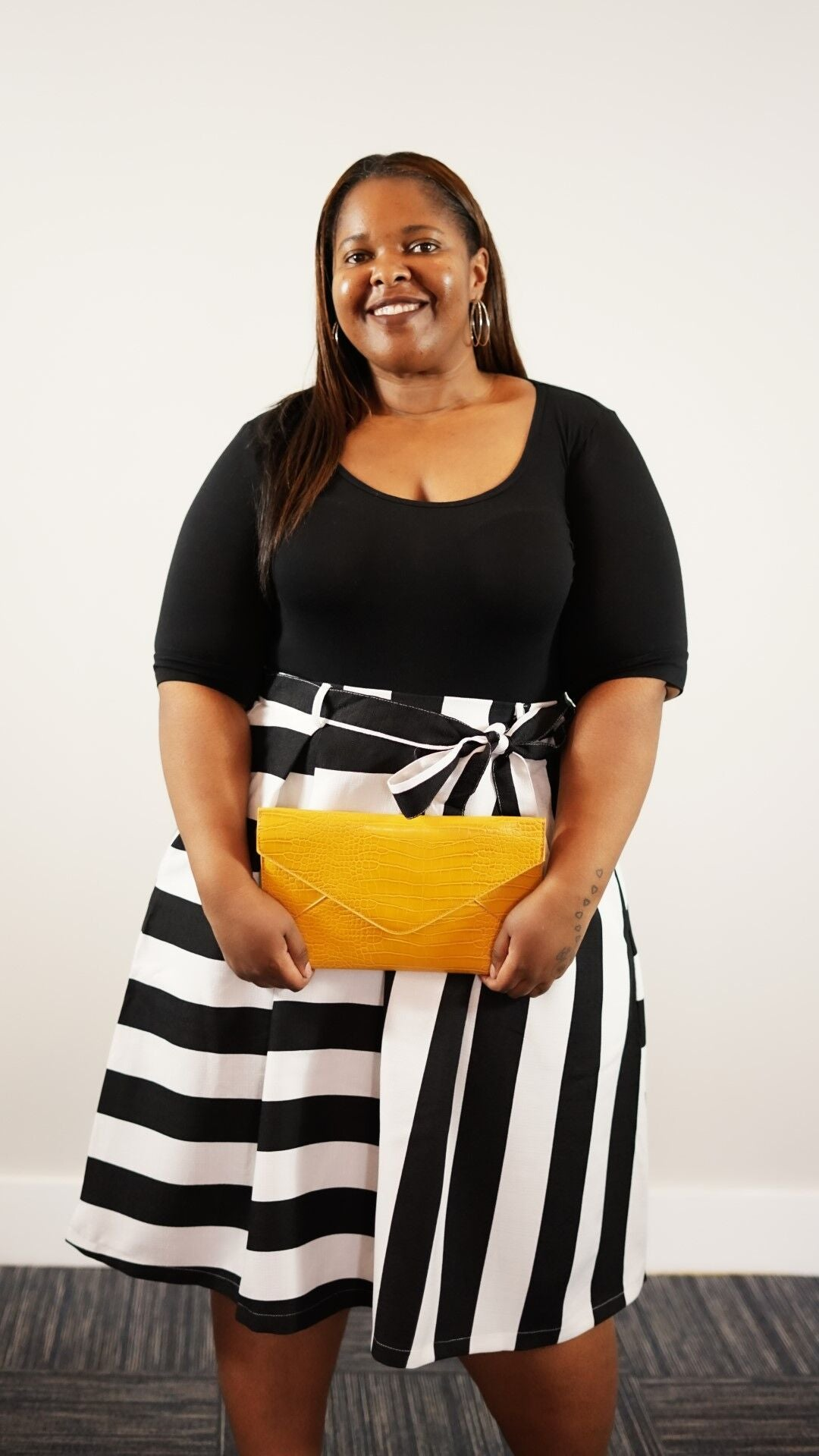 Alternate Front full body view of plus size model in a Queen's Stripe Skirt With Bow Tie