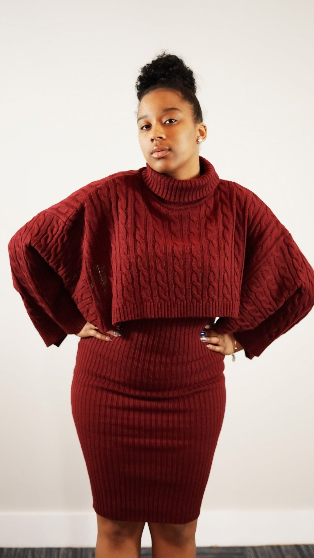 Front knee up view of plus size model in a burgundy Fine As Wine Sweater Dress 2-Piece Set