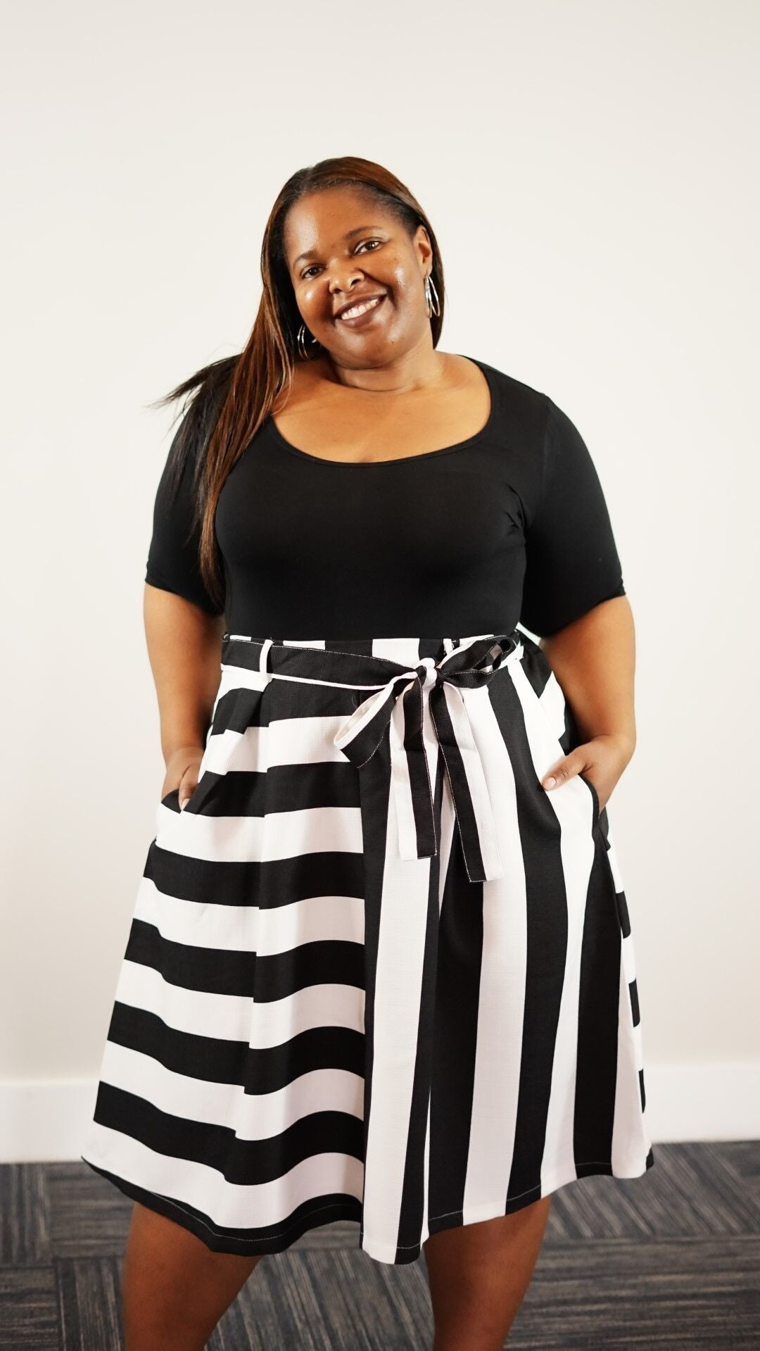 Front full body view of plus size model in a Queen's Stripe Skirt With Bow Tie