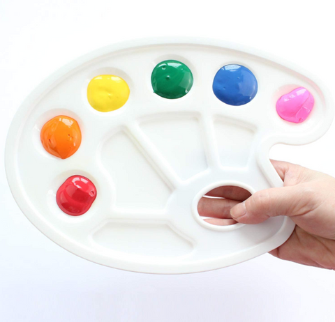 Paint tray has six round wells and four rectangular wells and a thumb hole. The wells are large enough for little not-fully-yet-coordinated hands with brushes to get into without messing up nearby colors.