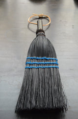 black whisking hand broom