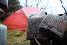 Load image into Gallery viewer, Merino Socks Drying Near A Kuiu Tent
