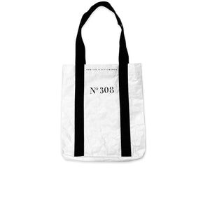 Back of the One by One Give Back Tote