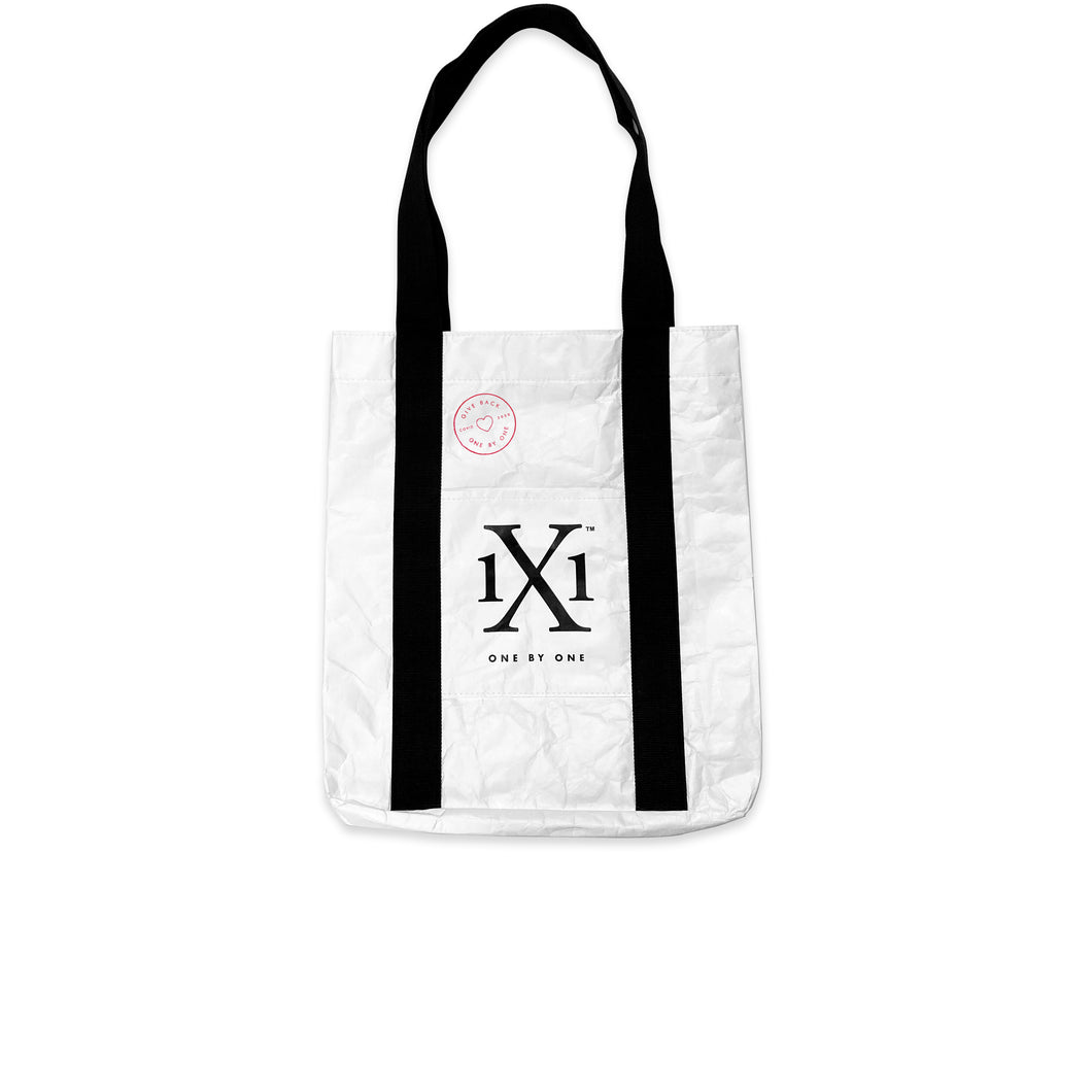 Front of the One by One Give Back Tote