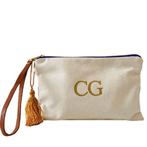 Personalised cream clutch bag with monogram, leather handle and tassel