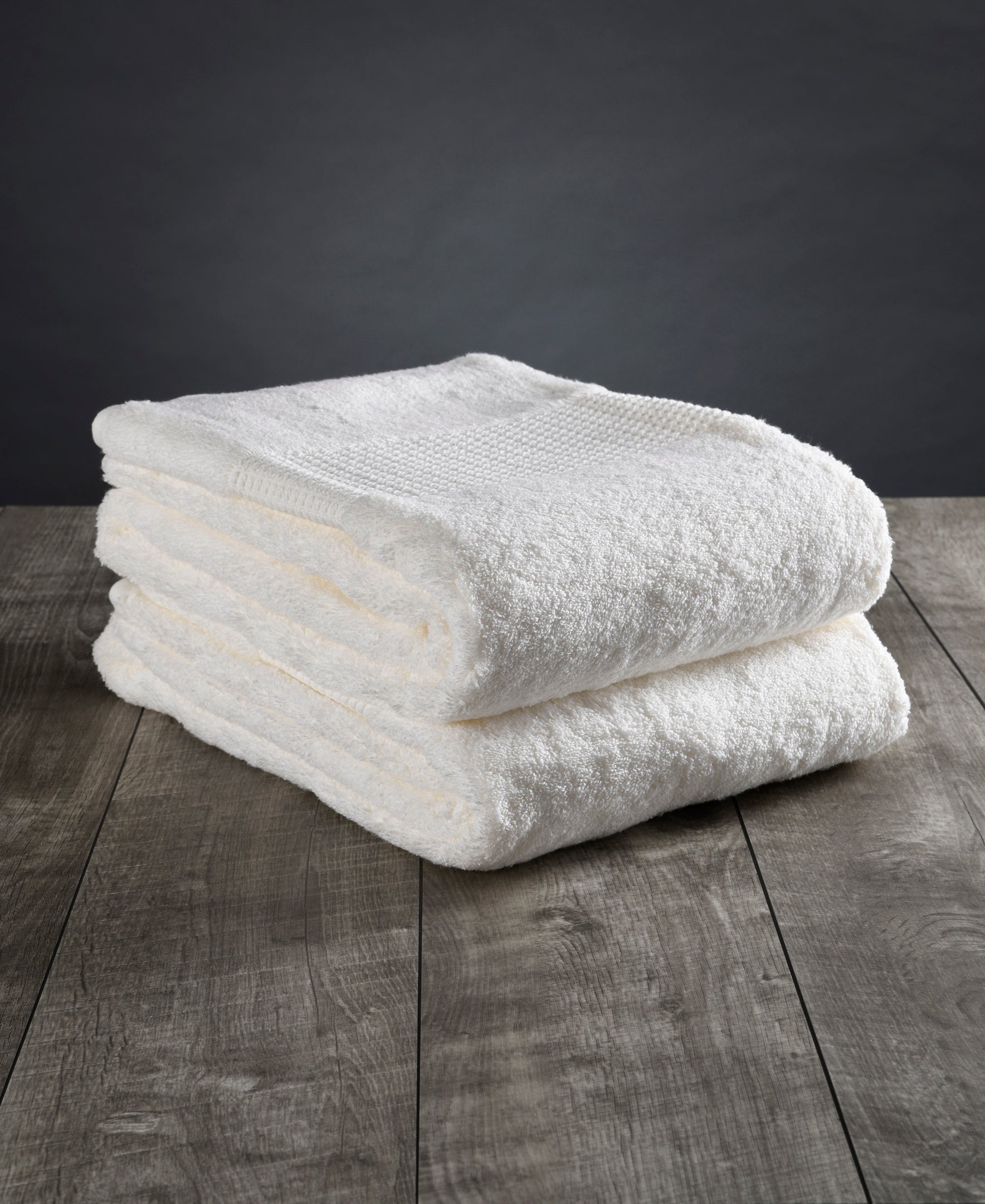 A stack of two white vegan towels.