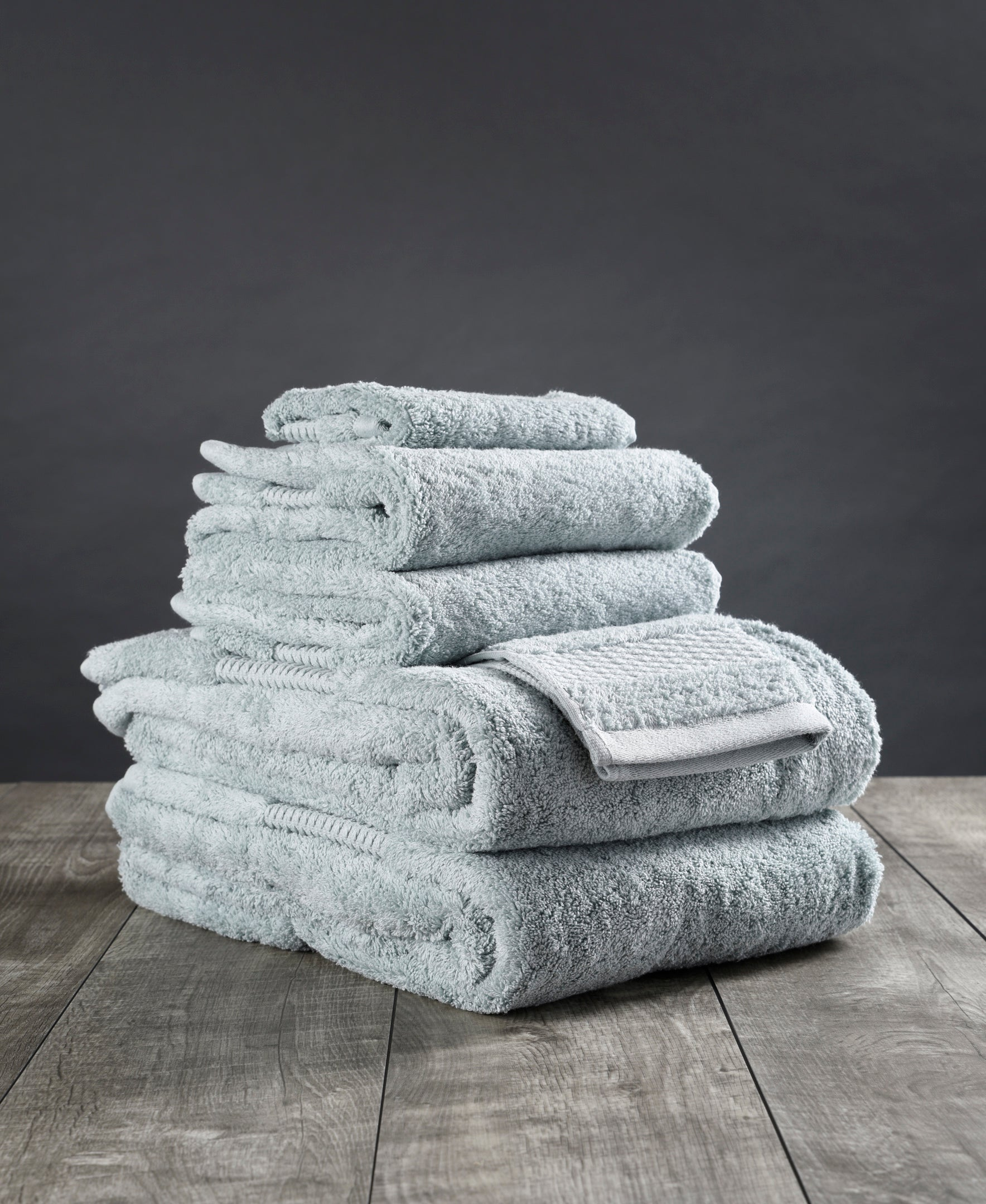 A stack of grey towels.