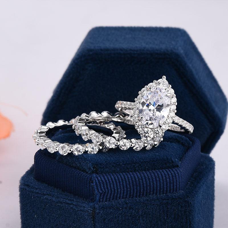 Hellojewelr Oval Cut 3-Pieces Wedding Set With Exclusive Design Halo