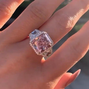Luxurious Halo Pink Stone Radiant Cut Three Stone Engagement Ring