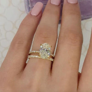 Yellow Gold Oval Cut Simulated Diamond Wedding Ring Set In Sterling Silver