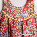Sleeveless dress with buttons on shoulder