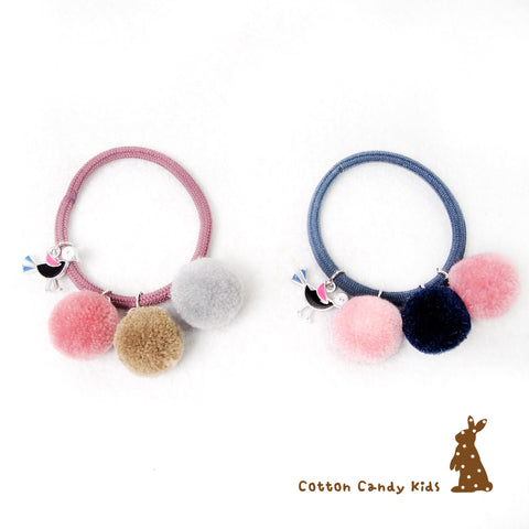 Adjustable pom pom hairband
