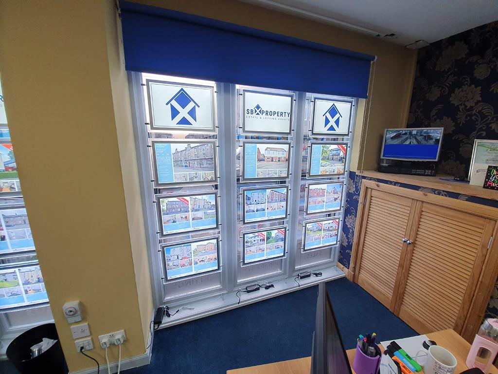 internal office showing estate agent window display
