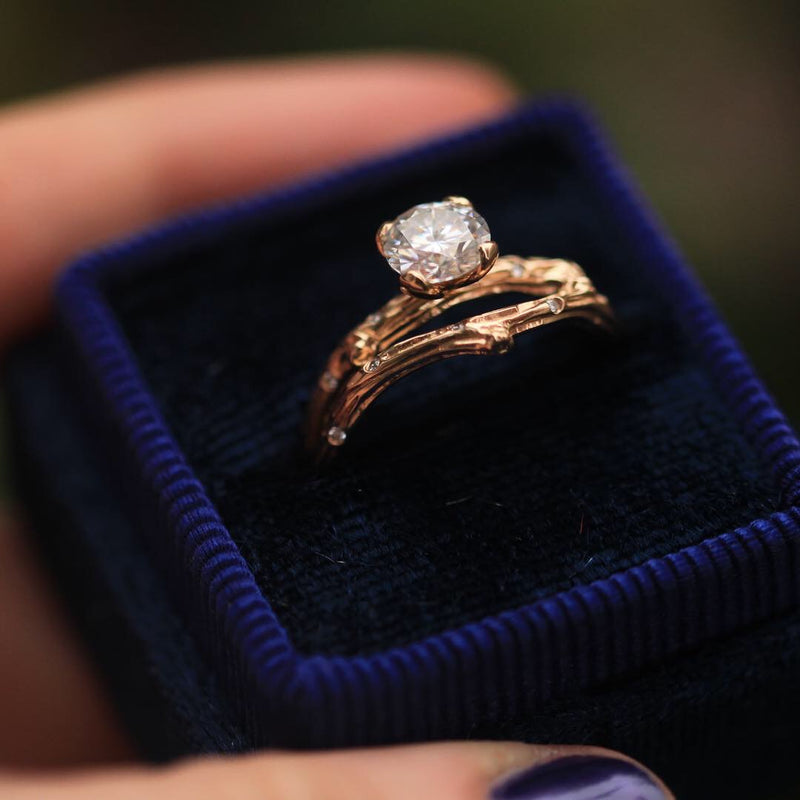 Nature inspired engagement ring with branch style band