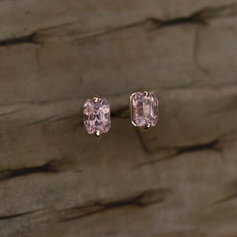 Unmatched oval pink sapphires from Sri Lanka with custom 14k Karat white gold setting with locking backs