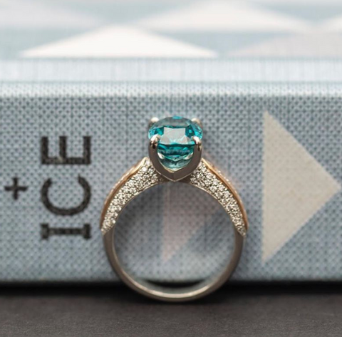 Sea Blue Zircon ring with diamond pave on the sides on a 14k gold band