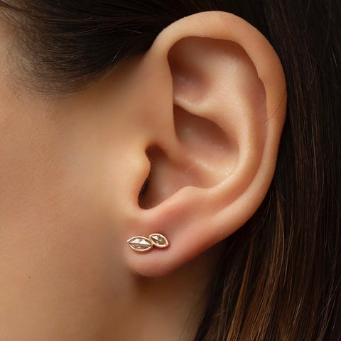 Unique custom single stud earring with a fancy rose-cut diamond and a rose cut champagne diamond. Available on a 18k Rose Gold setting.