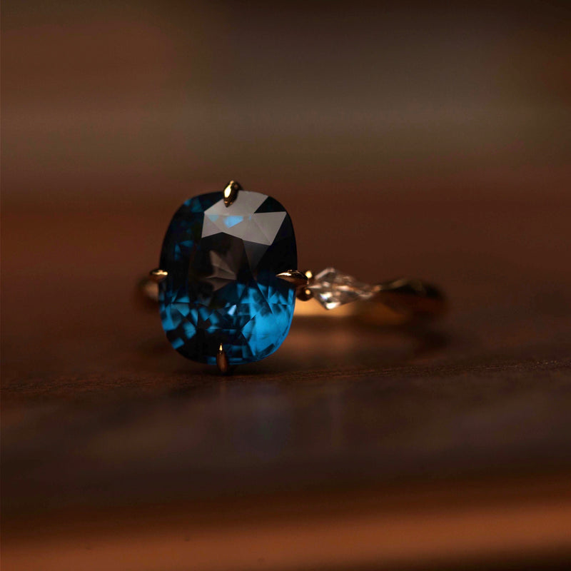 Four prong ring setting with 3.5 carat blue spinel center stone