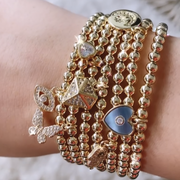 Mother of Pearl Heart Charm Goldfill Ball Bracelet