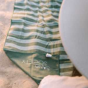 Olive - Green Striped Beach Towel fits into a complimentary small carry bag