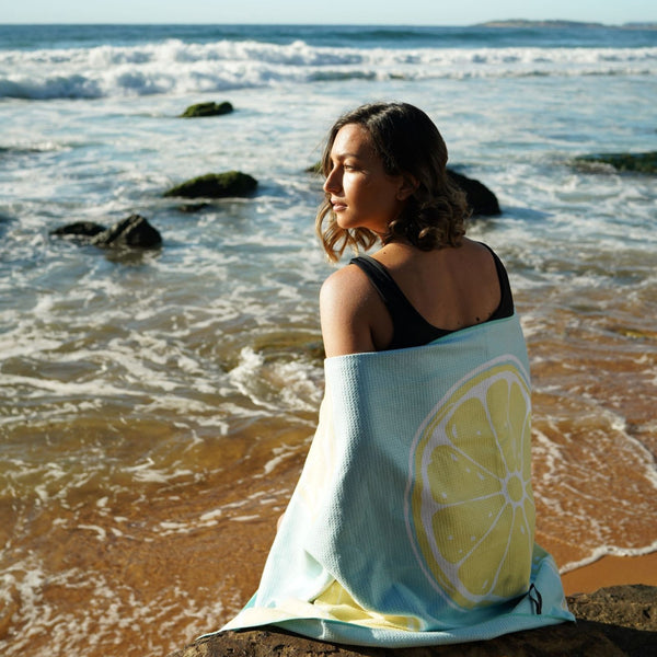 Lemons Beach Towel features sand free recycled microfiber technology