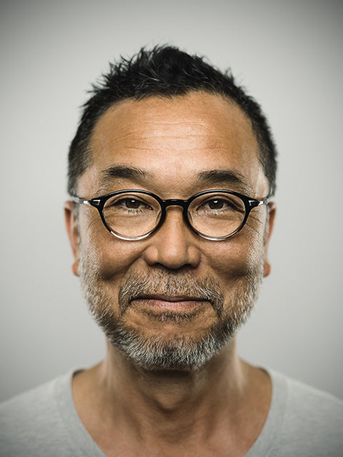Asian man wearing round eyeglasses