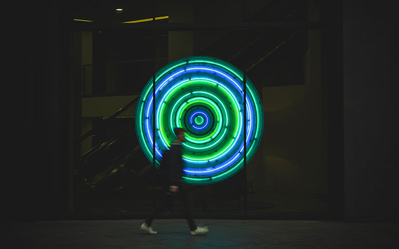 A boy exposed to blue and green lights