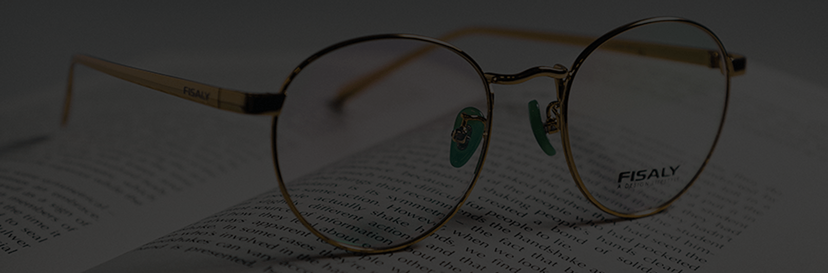 Prescription eyeglass frames resting on top of an open book