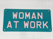 Woman at work sign teal blue and pink
