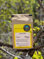 day star rock canyon coffee bag sitting in a tree in a spring seasonal setting