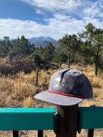 worn faded blue rock canyon coffee hat with mount sopris in background