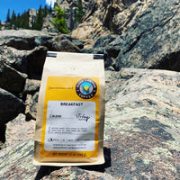 Breakfast blend coffee back sitting on rocks in Colorado mountains near Aspen